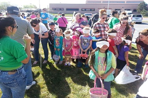 Children with their Easter Baskets get instructions for the Annual Easter Egg Hunt