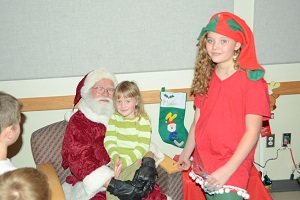 Santa and his Elf Visit with Children at our Annual Christmas Party