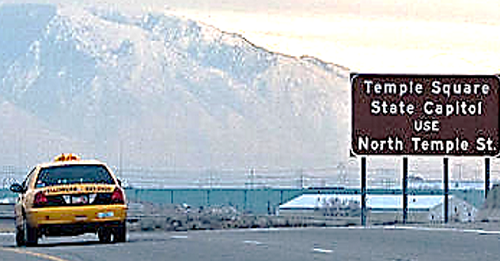 A cab is driving out in a rural part of Utah